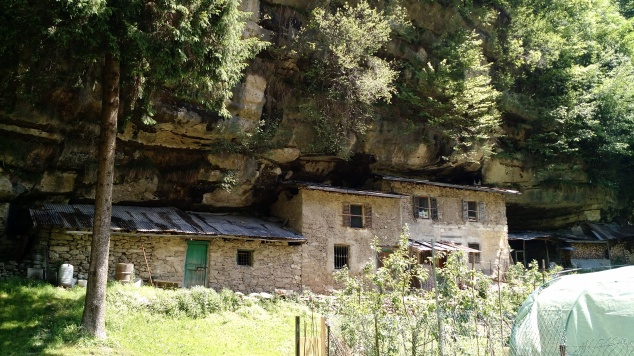 Old house built into/under the cliffside